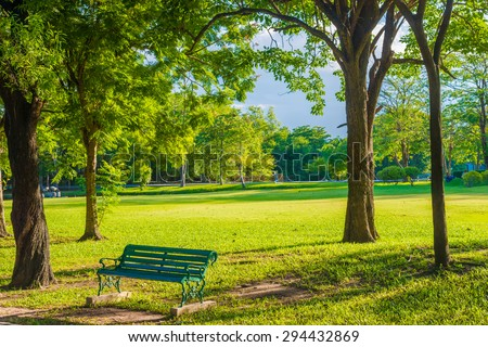 Empty bench in green park and sky with sun light, Green park outdoor - Shutterstock ID 294432869