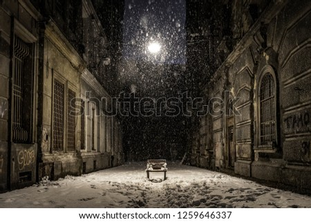empty bench on a dark alley