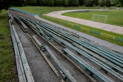 empty benches for spectators at the old abandoned stadium.