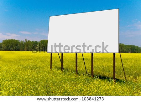 Empty billboard for your advertise on yellow rapeseed flower field