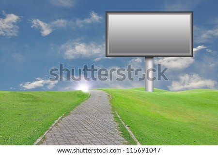 Empty billboard with the country road on blue sky