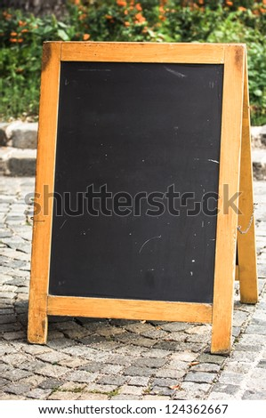 empty black board (menu board) at a restaurant - nice backgroud with space for text