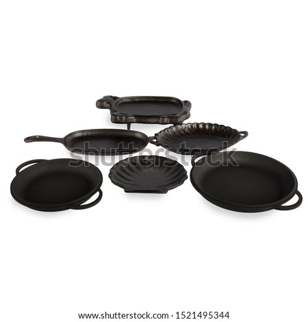 empty black iron cast plates, cast iron black pot, kettle cookware, isolated on perfect white background, stock photography