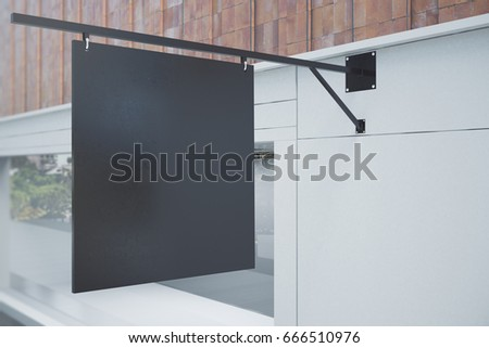 Empty black outdoor banner on concrete building with daylight. Cafe/bar/restaurant advertisement concept. Mock up, 3D Rendering
