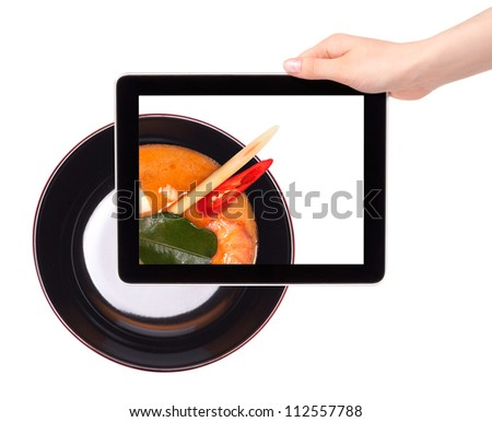 empty black plate and Chinese soup on a digital tablet screen.food concept