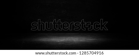 Empty black studio room. Dark background. Abstract dark empty studio room texture.  Product showcase spotlight background. Dark Studio Gallery