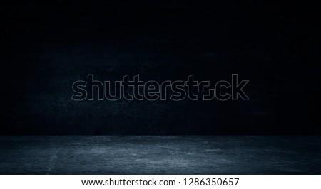 Empty black studio room. Dark background. Abstract dark empty studio room texture.  Product showcase spotlight background. Dark Studio Gallery. 3D Rendering