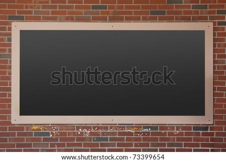 Empty blackboard on brick wall