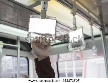 Empty blank billboard advertising on Handle on ceiling of bus train, MRT, prevent toppling.underground railway system or metro, ,selective focus,vintage color
