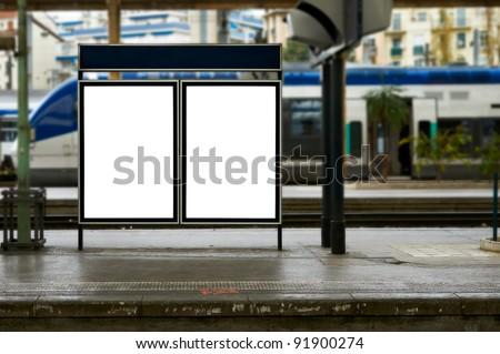 Empty blank billboard at train station