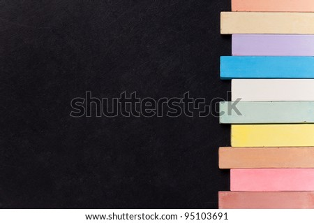 Empty blank black chalkboard with colorful chalk