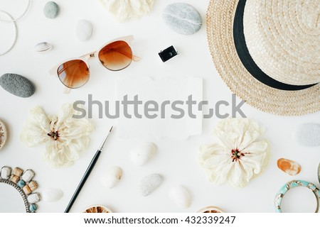 empty blank paper with straw, sunglasses, female accessories and dry white tulips on white background