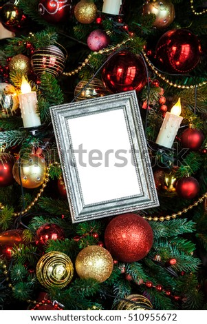 Empty blank photo frame in christmas decorated background with toys and candle lights