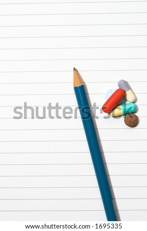 Empty blank ring, notepad, one pencil on white page with pills to indicate relation with pharmaceutical industry, or metaphor for office/school stress or work-related drug research