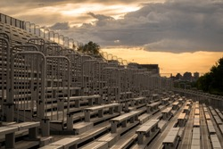 empty bleacher at sunset on a circuit
