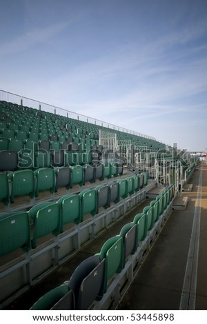 empty bleacher seating at an outdoor sports venue