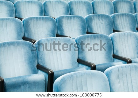 Empty blue chairs in a conference room