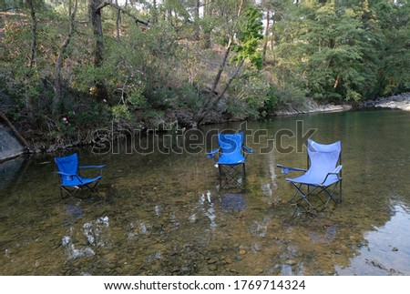 Empty blue chairs in river Stok fotoğraf ©