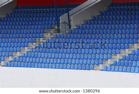 stock photo : Empty blue football stadium seats, simple and striking