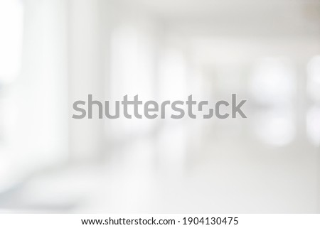 Empty blur white corridor hallway of modern white office building room with entrance door business blur background Foto stock ©