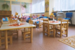 Empty blurred classroom in elementary school, kindergarten. Compulsory quarantine for all educational institutions concept