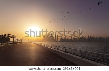 empty boardwalk in the morning sun with the skyline of Dubai in the background, Dubai, UAE