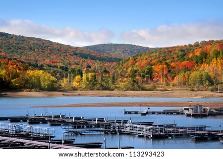 Empty boat dock and beautiful autumn landscape - stock photo