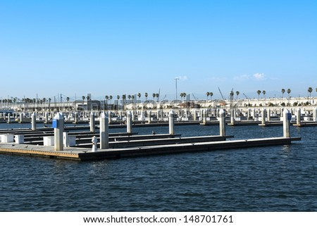 Empty boat docks in the Port of Los Angeles on a clear, sunny day