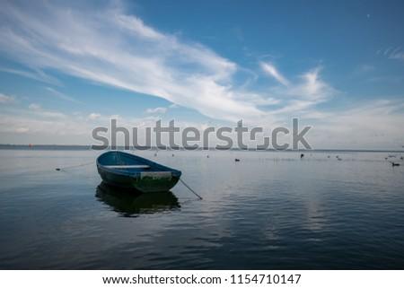 Empty Boat in the Sea Water #1154710147