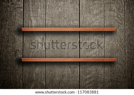 Empty bookshelf. Vintage wooden bookshelf over a grungy background
