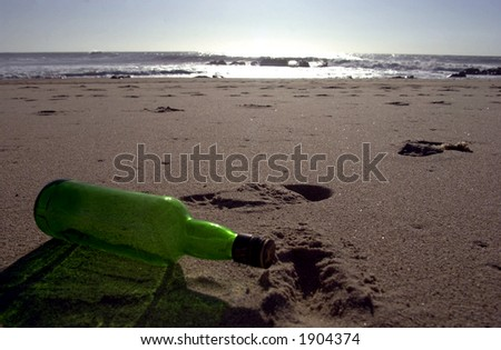 empty bottle left on the beach
