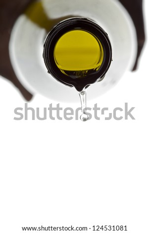 Empty bottle of white wine displayed on white background. - stock photo