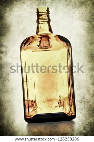 Empty bottle on grunge background