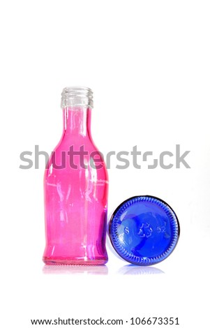 Empty bottles are recycled on white background.