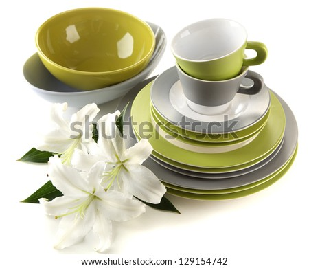 Empty bowls, plates and cups isolated on white