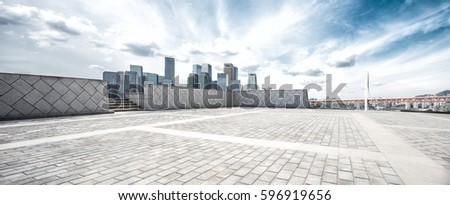 empty brick floor and cityscape and skyline of modern city