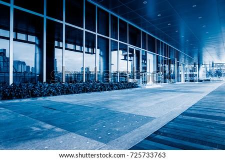 empty brick floor front of modern building?blue tone #725733763