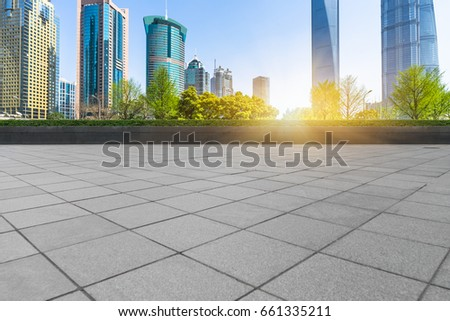 empty brick floor with cityscape and skyline #661335211