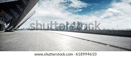 empty brick floor with cityscape of modern city #618994610