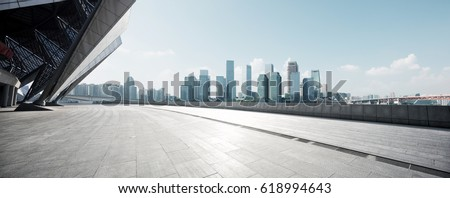 empty brick floor with cityscape of modern city #618994643