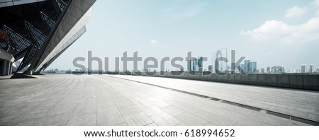 empty brick floor with cityscape of modern city #618994652