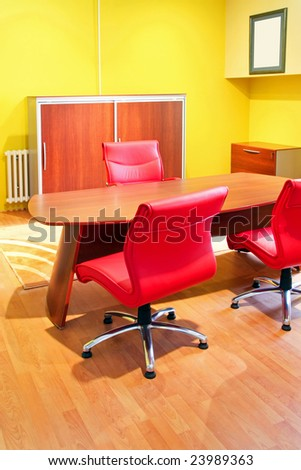 Empty bright office with warm color furniture