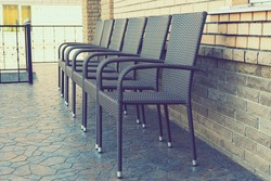 Empty brown chairs on the terrace. pandemic and social exclusion concept. toned