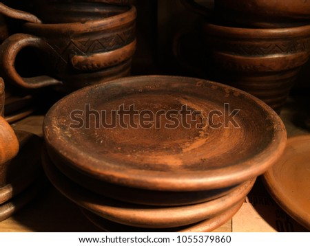 empty brown clay dish. Earthenware dish #1055379860