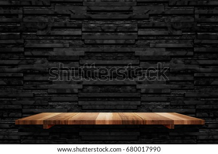 Empty brown plank wood shelf at black layer marble tile wall background,Mock up for display or montage of product or design #680017990