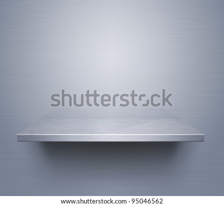Empty brushed metal shelf at the wall