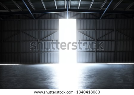 Empty building hangar with the door open with room for text or copy space. 3d rendering interior
