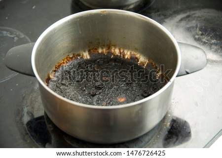 Empty burnt pot with black bottom #1476726425