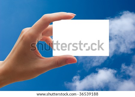 empty business card in a hand on sky backgroud