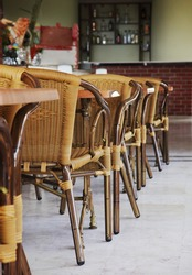 Empty cafe interior with wooden tables and chairs